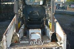 Bobcat 743 skid steer loader with 4 in 1 bucket
